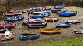 Low tide in the harbor. With fishing trawlers Stock Image