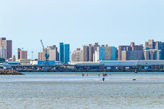Low Tide in Harbor Against cCty Skyline in Durban Royalty Free Stock Photography