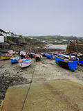Low tide in the harbor with slipway. Low tide in the harbor with fishing trawlers and slipway Stock Photo