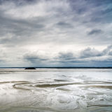 Low tide in Mont Saint Michel Bay. Normandy, France. Royalty Free Stock Photo