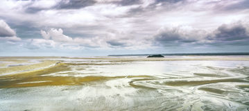 Low tide in Mont Saint Michel Bay. Normandy, France. Royalty Free Stock Images