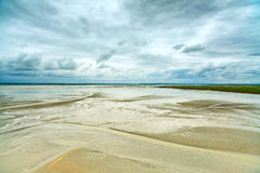 Low tide in Mont Saint Michel Bay. Normandy, France. Royalty Free Stock Photos