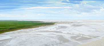 Low tide in Mont Saint Michel Bay. Panorama in Normandy, France. Royalty Free Stock Photos