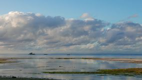 Tropical Siquijor beach with boats. A low tide morning clip from Siquijor white sand beaches. Local outrigger boats can be seen cruising across. There are also stock video