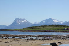 Low tide and Mountains Stock Photos