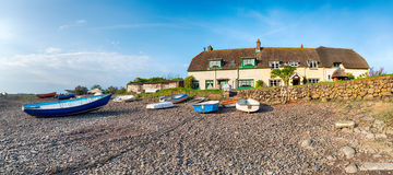 Low Tide at Porlock Weir. Cottages and fishing boats at low tide at Porlock Weir on the Somerset Coast and part of Exmoor National Park Stock Image
