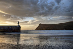 Low tide at Port Erin Bay and Brada Head at dawn Royalty Free Stock Image