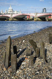 Low tide River Thames and London city skyline including St Paul' Royalty Free Stock Photos
