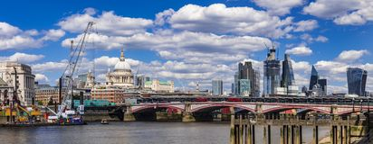 Skyline of London buildings and bridges over the Thames royalty free stock photography