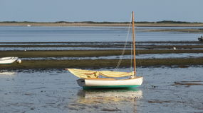 Low Tide. Sail boat resting on its hull waiting for the in coming tide Royalty Free Stock Photo