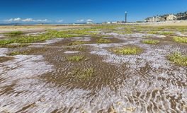Morecambe Beach at Low Tide. Low tide salty sand of Morecambe beach in Lancashire, United Kingdom Royalty Free Stock Image