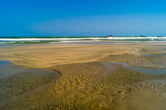 Low tide sand and water . Royalty Free Stock Photos