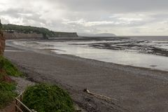 Low tide st Audries bay, Somerset. Landscape of the coast of Somerset with low tide at twilight royalty free stock image