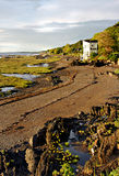 Low Tide on the St. Lawrence River. Beachfront living at low tide on the St. Lawrence River near Kamouraska in the province of Quebec Stock Photography