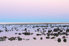 Low Tide stone desert at dusk Royalty Free Stock Photo