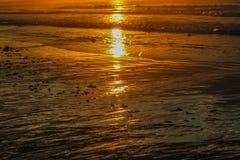 Low tide sunrise on the beach. Orange reflections on the sand at low tide sunrise on Old Orchard Beach, Maine Royalty Free Stock Photography
