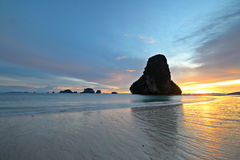 Low tide at sunset. Low tide with a vibrant colored sunset in the majestic scenery of Railey Bay, Krabi, Southern Thailand. Blurred motion, very long exposure Royalty Free Stock Image