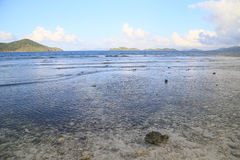 Low tide at sunset on a beach of St Thomas Island, US VI. Stock Photos