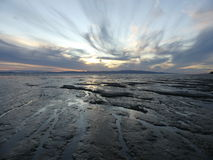 Low tide at sunset. New Zealand beach scene at low tide. Mud flats Stock Photography