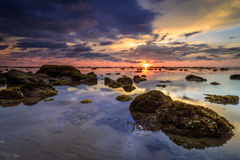 Low tide sunset. This photo was taken during sunset when the water of the sea was low tide Royalty Free Stock Photos