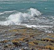 Low tide surge. Waves enter a beach near Durban stock photo