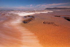 Low tide. At the Swartvlei river mouth near Sedgefield (South Africa&#x29 Stock Photos