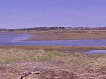 Low tide tidal pool 3493. Low tide tidal pool showing sand and blue sky royalty free stock image