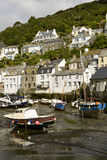 Low tide time in village harbour, Polperro Stock Images