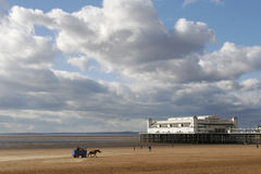 Low tide at the traditional seaside pier at Weston-super-mare UK Stock Image