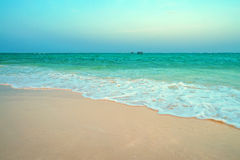 Low tide on tropical beach Stock Images