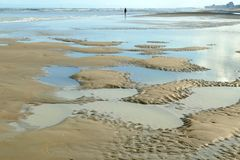 Little sand islands and water basins at low tide in the Wadden Sea stock photo