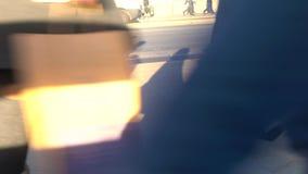 Low view of commuters legs walking across busy London Bridge, London stock footage