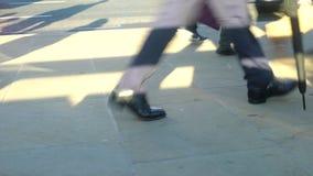 Low view of commuters legs walking across busy London Bridge, London stock video