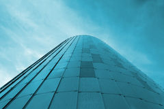 Low view image. Modern glass building skyscrapers over blue bright clear sky. Stock Photo