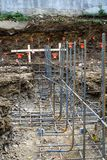 Low view of lines of steel rebar in unpoured footings Royalty Free Stock Photo