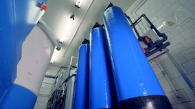 A low view on many oxygen water tanks. A low angle view on a storage room  with many blue water tanks stock footage