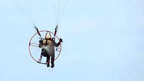 Low view of a motor paraglider sky Stock Photo
