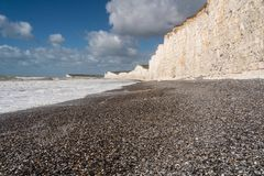 Low view of the rocky beach and Seven Sisters at Birling Gap, Sussex royalty free stock image