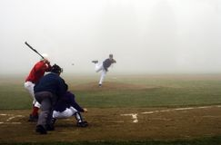 Low Visibility. The fog rolls in on a high school baseball game in Maine Stock Image