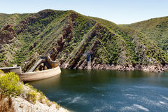 The low water level of the Kouga Dam. The Kouga Dam is an arch dam on the Kouga River about 21 km west of Patensie in Kouga Local Municipality, South Africa Stock Photography