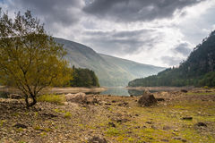 Low water at Thirlmere with Helvellyn Royalty Free Stock Photos