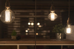 Low Watt Tungsten Bulbs. Hanging from Cord Royalty Free Stock Image