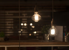 Low Watt Tungsten Bulbs. Hanging from Cord Royalty Free Stock Photos