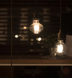 Low Watt Tungsten Bulbs. Hanging from Cord Royalty Free Stock Photography