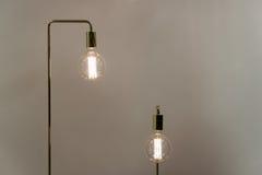 Low Watt Tunsgten Bulb. Low Watt Tungsten Bulbs With Brass Fittings Stock Photo