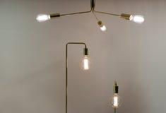 Low Watt Tunsgten Bulb. Low Watt Tungsten Bulbs With Brass Fittings Royalty Free Stock Photos