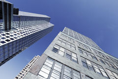 Office Buildings Skyscrapers New York. Low & wide angle tilted view of office buildings scraping the Manhattan sky Royalty Free Stock Photos