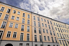 East Berlin Low Angle Building and Cloudy Sky. Low and wide angle view of an aparment building under cloudy Berlin sky Royalty Free Stock Photography