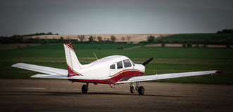 A low winged private plane. A simple light aircraft, parked at an airfield Royalty Free Stock Image