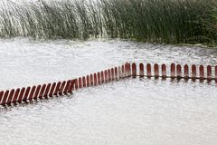 low wooden fence in the water royalty free stock image
